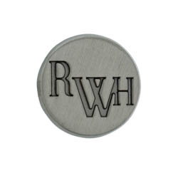 "Circle Tie Tack that reads ""RWH"", the shortened version of Return with Honor"